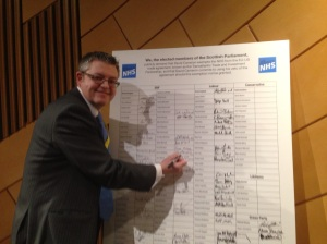 Stuart McMillan MSP signing TTIP pledge - Feb 15