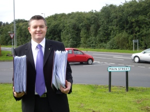 Picture of Stuart McMillan MSP, from September 2008, with survey responses from residents regarding road safety on the A78 Inverkip.